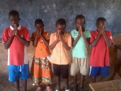 Classic children were praying during saturday club