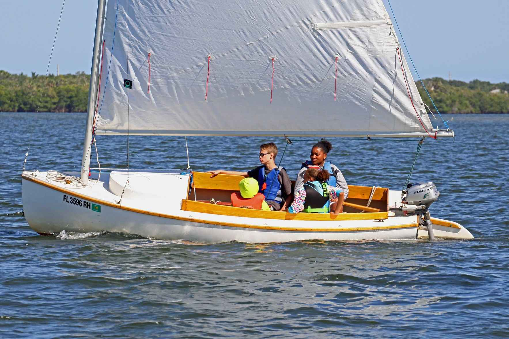 Donate now and help a local child set sail, on the water and beyond! image