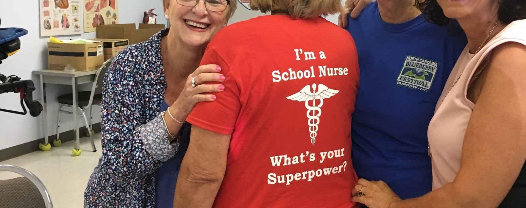 Superhero School Nurses work hard to keep kids healthy! image