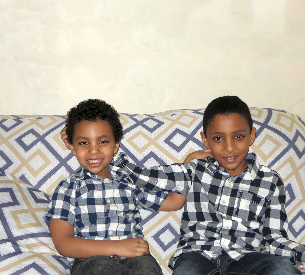 Tonight, these two boys will share a twin mattress on the floor next to their parents' bed. image